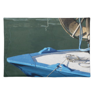 Prow of a wooden fishing boat with trawl winch placemat