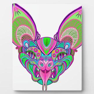 Psychedelic rainbow bat plaque