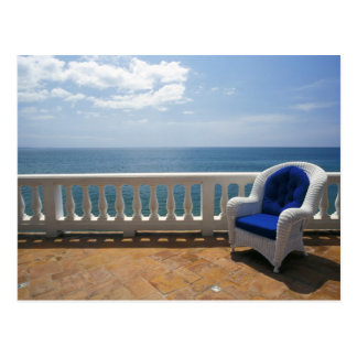 Puerto Rico. Wicker chair and tiled terrace at Postcard