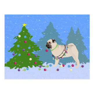 Pug decorating a Christmas Tree in the forest Postcard