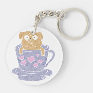 Pug dog sitting in purple  cup with heart. Double-Sided round acrylic key ring