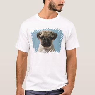 Pug Puppy Against Blue Background T-Shirt