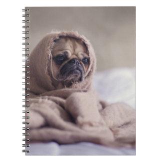 Pug puppy Dog Cuddling in a warm towel Blanket Notebook
