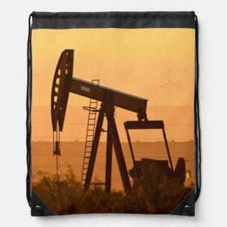Pump Jack Pumping Oil In West Texas, USA Backpacks