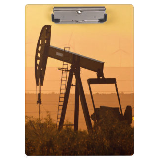 Pump Jack Pumping Oil In West Texas, USA Clipboard