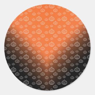 Pumpkin pattern on orange black fade round sticker