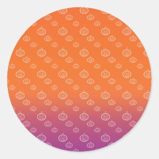 Pumpkin pattern on purple orange fade round sticker