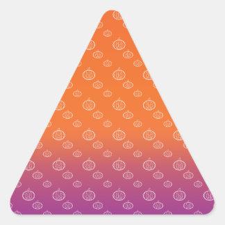 Pumpkin pattern on purple orange fade triangle sticker