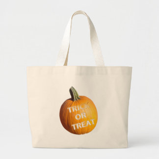 Pumpkin with Trick or Treat on it Canvas Bags