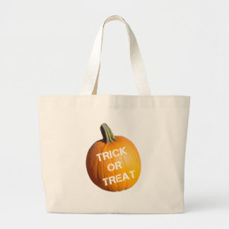 Pumpkin with Trick or Treat on it Tote Bags