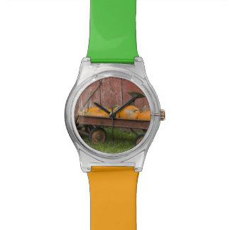 Pumpkins in old wagon wrist watch
