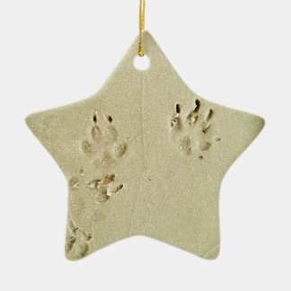Puppy prints in the sand ceramic ornament