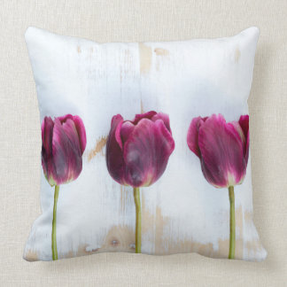 PUR-polarize tulips on white rustic wooden backgro Throw Cushions