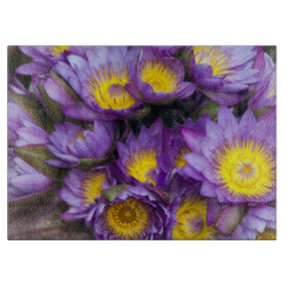 Purple and yellow water lilies cutting board