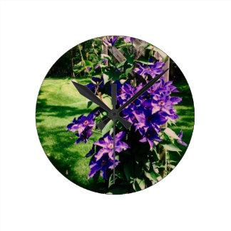Purple clematis flowers wall clocks