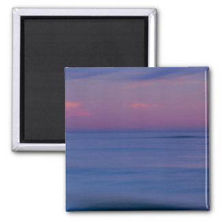 Purple-colored sunrise on ocean shore 2 square magnet