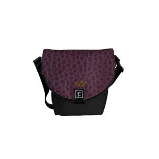 Purple connotes sophistication. messenger bag