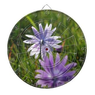 Purple daisy flowers on green background dartboard