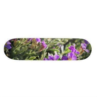 Purple flowers in bloom during Spring Skate Deck