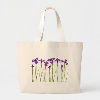 Purple irises isolated on a white background large tote bag