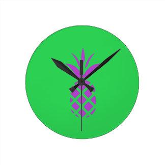 Purple pine apple in green. round clock