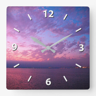 Purple, pink, and blue clouds ocean sunset photo square wall clock