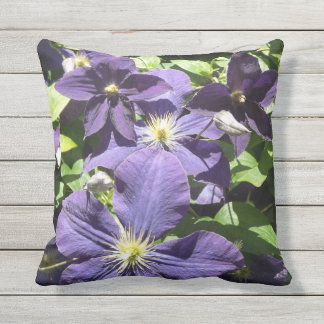Purple Star Clematis Flowers with Greenery Outdoor Cushion