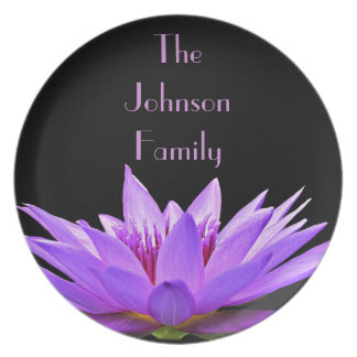 Purple water lily on black background party plates