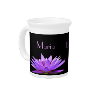 Purple water lily on black background pitcher