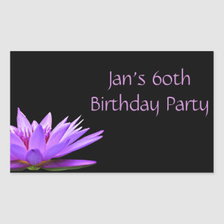 Purple water lily on black background rectangular sticker