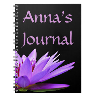 Purple water lily on black background spiral notebooks