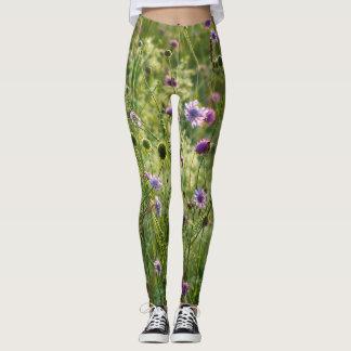 Purple wild flowers in a green meadow leggings