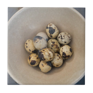 Quails eggs in a bowl tile