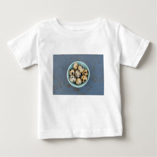 Quails eggs in a green bowl baby T-Shirt