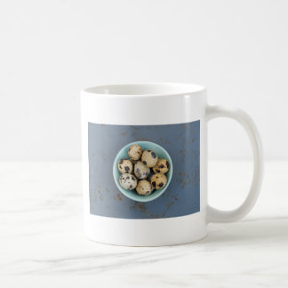 Quails eggs in a green bowl coffee mug
