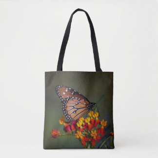 Queen butterfly on tropical milkweed tote bag