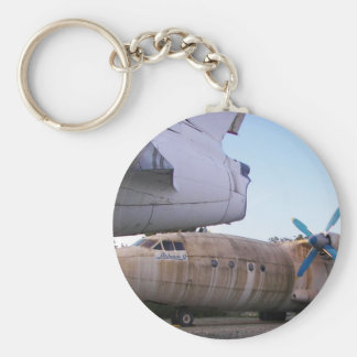 Queing never to fly again. basic round button key ring