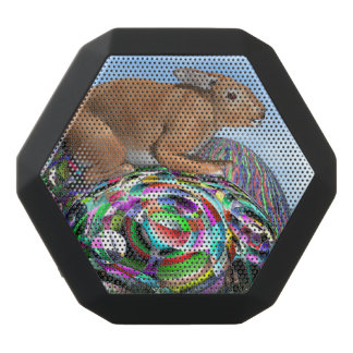 Rabbit on its colorful egg for Easter - 3D render