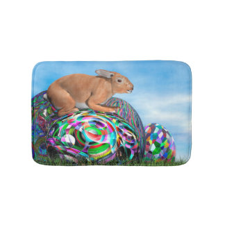 Rabbit on its colorful egg for Easter - 3D render Bath Mats