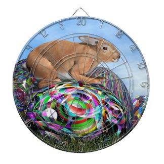 Rabbit on its colorful egg for Easter - 3D render Dartboards