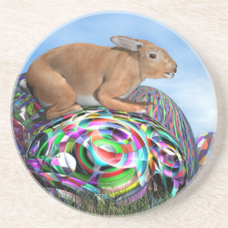 Rabbit on its colorful egg for Easter - 3D render Drink Coasters