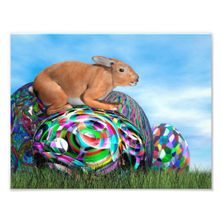 Rabbit on its colorful egg for Easter - 3D render Photo
