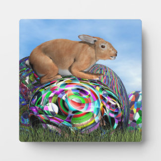 Rabbit on its colorful egg for Easter - 3D render Plaque