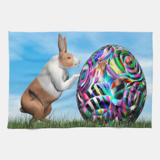 Rabbit pushing easter egg - 3D render Tea Towel