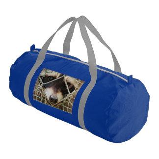 raccon on duffle gym bag
