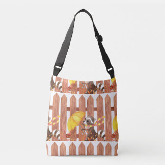 racoon with umbrella walking by fence crossbody bag