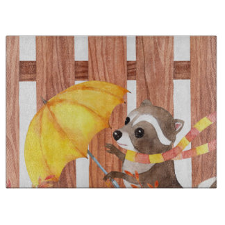 racoon with umbrella walking by fence cutting board