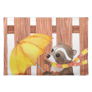 racoon with umbrella walking by fence placemat