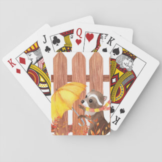 racoon with umbrella walking by fence playing cards
