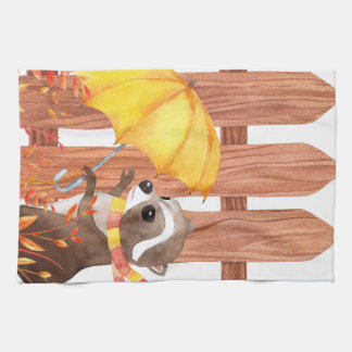 racoon with umbrella walking by fence tea towel